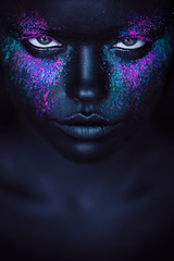 woman in black paint and pink powder