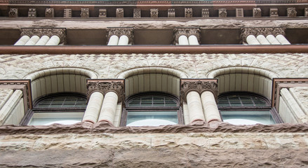 Romanesque Revival Architecture in Old City Hall, Toronto made with red sandstone