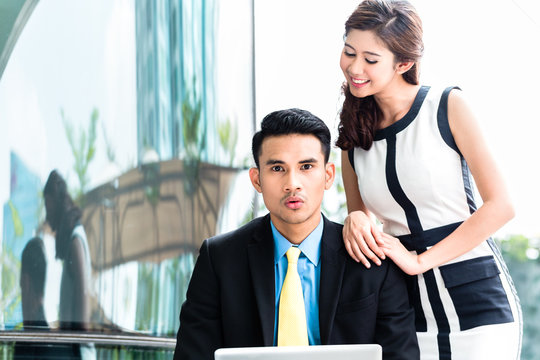 Asian Businesspeople with sexual harassment problem