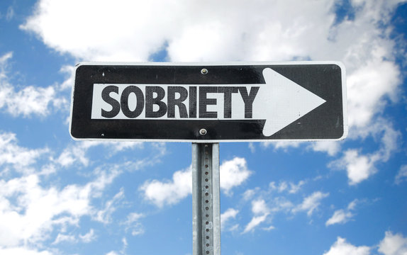 Sobriety direction sign with sky background