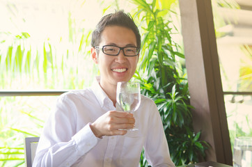 Asian man having a glass of drinks