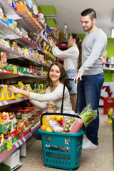Customers buying food in supermarket
