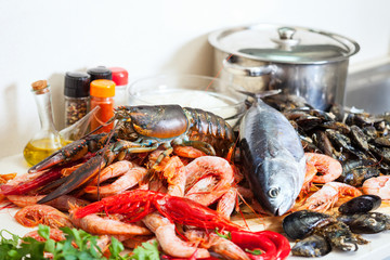 Fresh raw seafoods and fish in  kitchen