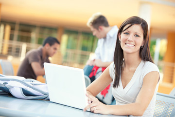 College: Smiling Female Student Studying Outdoors With Laptop