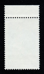 Reverse side of a postage stamp.