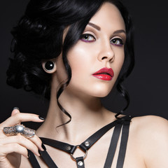 Beautiful Girl in the Gothic style with leather accessories and