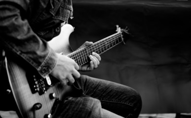 The man play guitar