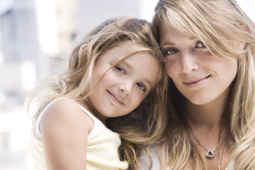 Beautiful blonde mother and daughter