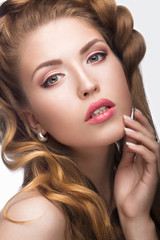 Beautiful girl with a light Nude make-up and blond hair. Beauty