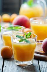 Sweet fresh peach juice with ice