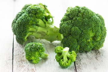Broccoli on a white wooden background