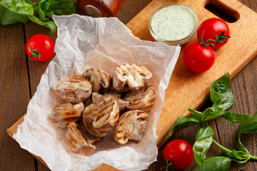 Grilled champignons with sauce