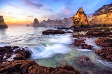 Fototapete - Magnificent coast scenery at sunrise