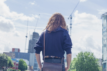 Woman looking at building works