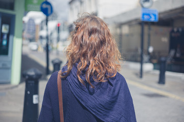 Young woman walking in the street