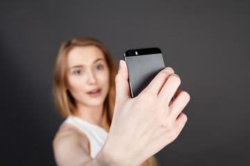 young pretty blonde women taking selfie