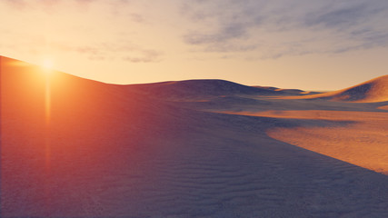 Sun sets behind the desert dunes