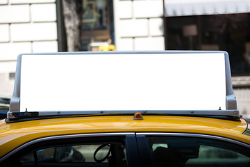 White blank billboard on the taxi.