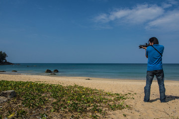 photographer / Photographer used view at the beach is hobby.