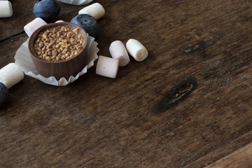 Belgian chocolate and marshmallow on a wooden table