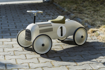 old metal car for children from the 19 th century