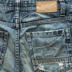 jeans pants with back pocket and brown leather tag