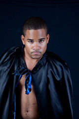 Black man in black and blue cape