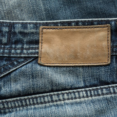 brown leather tag label on blue jeans
