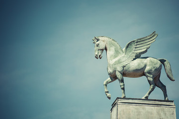 statue of pegasus on the roof of opera in poznan poland