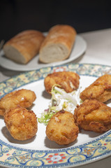 "Authentic spanish croquettes, ""croquetas"", served in a typical spanish restaurant."