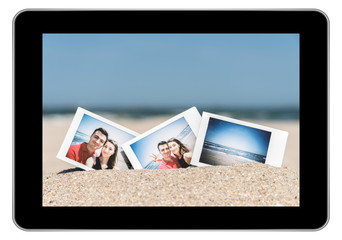 Instant Photos Of Young Couple On Beach On Modern Black Tablet