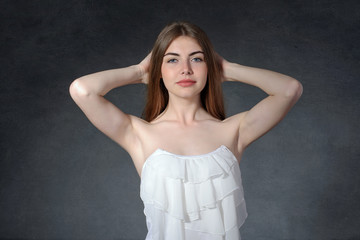 Calm, laziness, tiredness concept. Woman raised her arms stretch