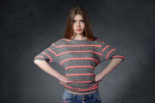 Anger side, a charge concept. Woman standing with hands on hips