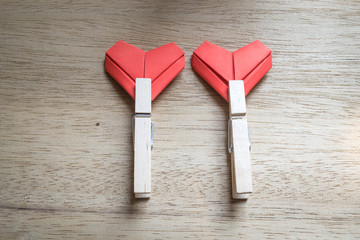 paper hearts and wooden cloth pegs