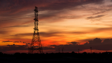 High voltage electricity pylon after sunset.
