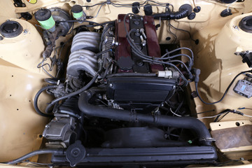 Parts under the hood of car