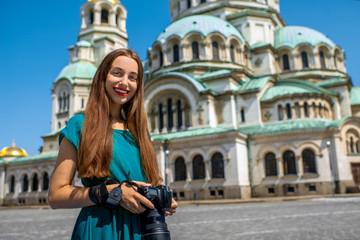 Tourist near the St. Alexander Nevsky Cathedral