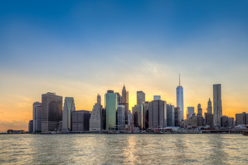 Wall Mural - New York City Manhattan downtown skyline at sunset