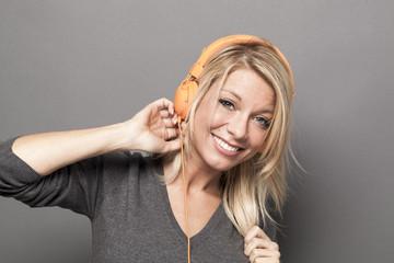 pretty young woman enjoying good vibes on earphone