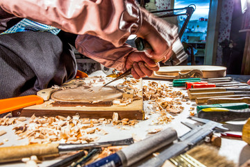 carpenter engraving violin with tools