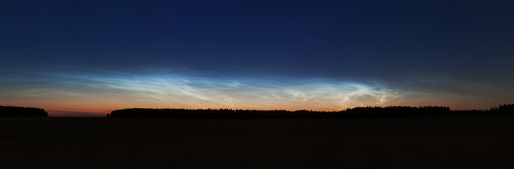 Landscape with noctilucent clouds