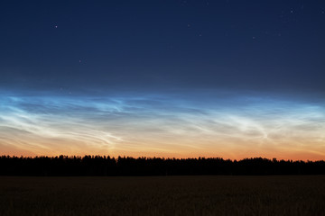 Landscape with rare noctilucent clouds