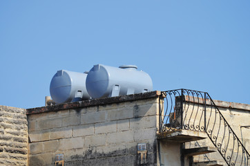 water shortage: Water tank on a private home in Malta, southern Europe