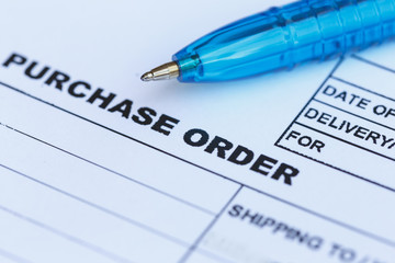purchase order with blue pen in the office
