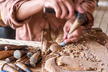 Craftsman wooden carving.
