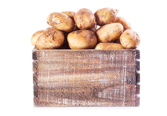 fresh potatoes in wooden box