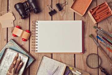 Notebook mock up for artwork or logo design presentation with creative objects. View from above