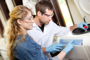 Scientists research in a lab environment