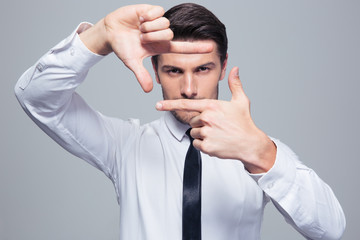 Businessman making frame gesture