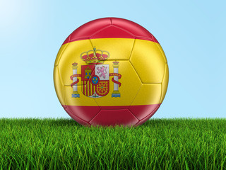 Soccer football with Spanish flag on grass. Image with clipping path